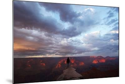 A Man Looking Out over the Grand Canyon at Sunrise from a Rock Promontory-Luis Lamar-Mounted Photographic Print