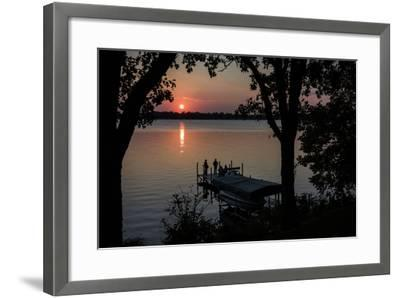 Residents Watch a Late Summer Sunset from their Dock on West Okoboji Lake-Kent Kobersteen-Framed Photographic Print