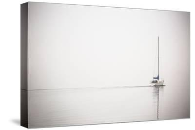 A Lone Sailboat Motors Through Morning Fog on the Occoquan River, Near the Potomac River-Kent Kobersteen-Stretched Canvas Print