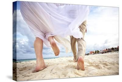 Newlyweds Run Down the Beach on the Riviera Maya in Mexico-Michael Lewis-Stretched Canvas Print