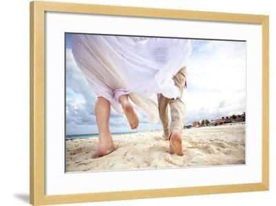 Newlyweds Run Down the Beach on the Riviera Maya in Mexico-Michael Lewis-Framed Photographic Print