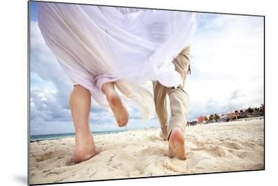 Newlyweds Run Down the Beach on the Riviera Maya in Mexico-Michael Lewis-Mounted Photographic Print