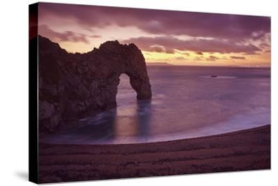 The Durdle Door Rock Arch at Dusk-Nigel Hicks-Stretched Canvas Print