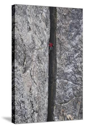 A Man Climbs in a Crevasse Between Two Massive Rock Cliffs in Yosemite National Park, California-Keith Ladzinski-Stretched Canvas Print