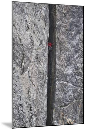 A Man Climbs in a Crevasse Between Two Massive Rock Cliffs in Yosemite National Park, California-Keith Ladzinski-Mounted Photographic Print