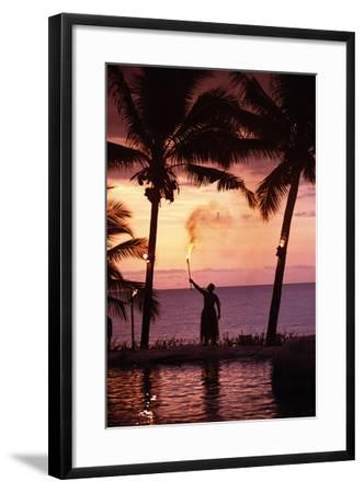 Native in a Grass Skirt Holding a Flaming Torch by Coast at Sunset-Design Pics Inc-Framed Photographic Print