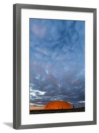 A Cloud Bank from an Approaching Storm Turns Magenta as it Shrouds Uluru and the Desert Plain-Jason Edwards-Framed Photographic Print