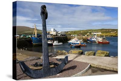 An Anchor Stands on the Shore Overlooking Fishing Boats in Portmagee-Chris Hill-Stretched Canvas Print