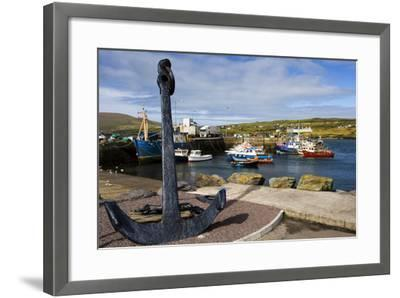 An Anchor Stands on the Shore Overlooking Fishing Boats in Portmagee-Chris Hill-Framed Photographic Print