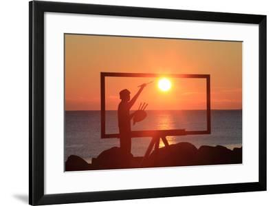 A Sculpture of an Artist Painting in New Castle, New Hampshire Frames the Sunrise-Robbie George-Framed Photographic Print