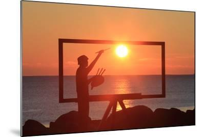 A Sculpture of an Artist Painting in New Castle, New Hampshire Frames the Sunrise-Robbie George-Mounted Photographic Print