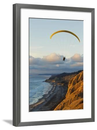 California, La Jolla, Paraglider Flying over Ocean Cliffs at Sunset. Editorial Use Only-Design Pics Inc-Framed Photographic Print