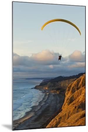 California, La Jolla, Paraglider Flying over Ocean Cliffs at Sunset. Editorial Use Only-Design Pics Inc-Mounted Photographic Print