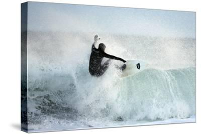 A Surfer Rides a Winter Wave Off the Coast of Maine-Robbie George-Stretched Canvas Print