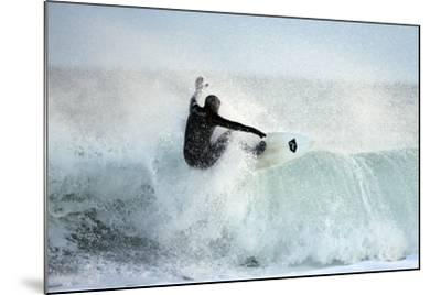 A Surfer Rides a Winter Wave Off the Coast of Maine-Robbie George-Mounted Photographic Print