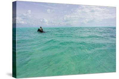 A Woman Riding a Horse in Turquoise Caribbean Waters, Near Shore-Mike Theiss-Stretched Canvas Print