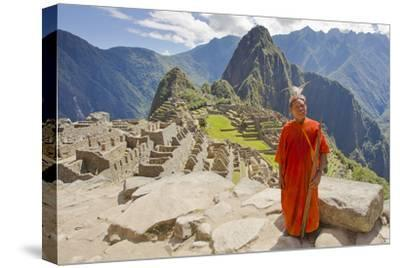 A Local Tribesman with a Spear Chants on a Cliff at Machu Picchu-Mike Theiss-Stretched Canvas Print