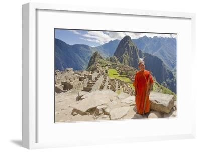 A Local Tribesman with a Spear Chants on a Cliff at Machu Picchu-Mike Theiss-Framed Photographic Print