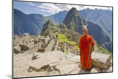 A Local Tribesman with a Spear Chants on a Cliff at Machu Picchu-Mike Theiss-Mounted Photographic Print