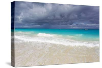 Storm Clouds Roll in over Turquoise Waters and a Beach-Mike Theiss-Stretched Canvas Print