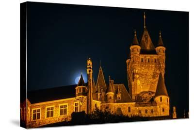 The Moon, Illuminated Sunlight Reflected on Earth's Surface, Behind the Imperial Castle of Cochem-Babak Tafreshi-Stretched Canvas Print