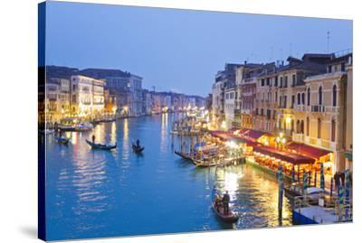 Outdoor Cafes and Gondolas Line Venice's Grand Canal Reflecting City Lights at Dusk-Mike Theiss-Stretched Canvas Print