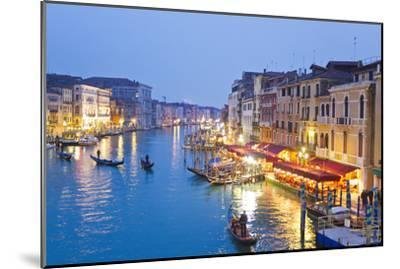 Outdoor Cafes and Gondolas Line Venice's Grand Canal Reflecting City Lights at Dusk-Mike Theiss-Mounted Premium Photographic Print