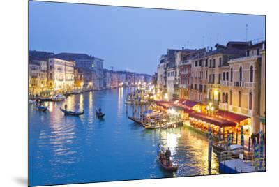 Outdoor Cafes and Gondolas Line Venice's Grand Canal Reflecting City Lights at Dusk-Mike Theiss-Mounted Photographic Print