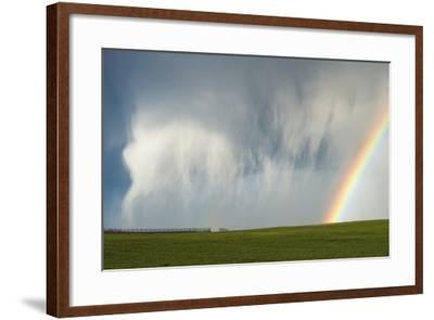 A Thunderstorm Produces a Curtain of Falling Hailstones Next to a Rainbow-Jim Reed-Framed Photographic Print