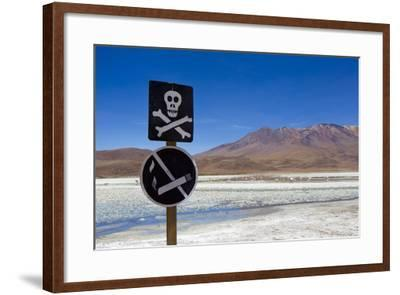 A Skull and Cross Bones Danger Sign on Edge of a Dried Up Lagoon-Mike Theiss-Framed Photographic Print