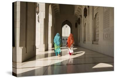 Two Traditionally Dressed Women Walk in a Corridor of the Sultan Qaboos Grand Mosque-Michael Melford-Stretched Canvas Print