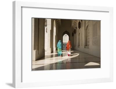 Two Traditionally Dressed Women Walk in a Corridor of the Sultan Qaboos Grand Mosque-Michael Melford-Framed Photographic Print