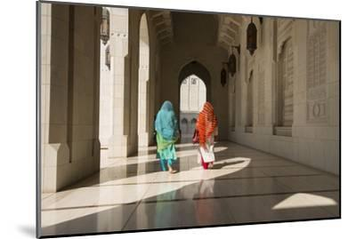 Two Traditionally Dressed Women Walk in a Corridor of the Sultan Qaboos Grand Mosque-Michael Melford-Mounted Photographic Print