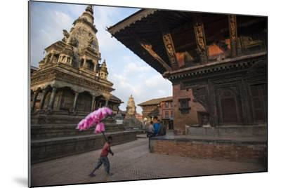 A Young Cotton Candy Seller Walking Through Durbar Square-Michael Melford-Mounted Photographic Print