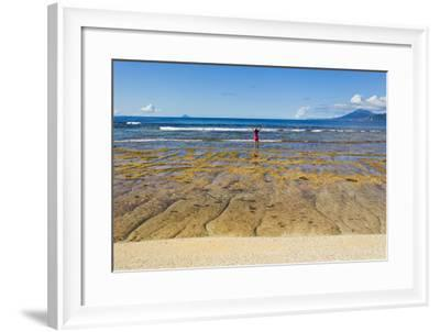 A Woman in a Pink Shirt Takes in a View of the Pacific Ocean from One the Batanes Islands-Mike Theiss-Framed Photographic Print