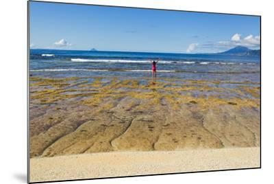A Woman in a Pink Shirt Takes in a View of the Pacific Ocean from One the Batanes Islands-Mike Theiss-Mounted Photographic Print