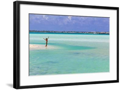 A Woman in a Bikini Posing in the Turquoise Waters at Bora Bora-Mike Theiss-Framed Photographic Print