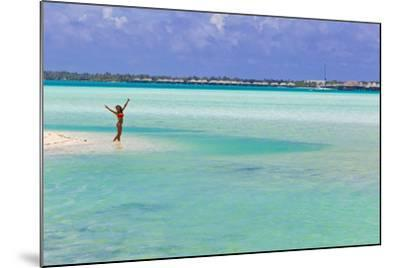 A Woman in a Bikini Posing in the Turquoise Waters at Bora Bora-Mike Theiss-Mounted Photographic Print