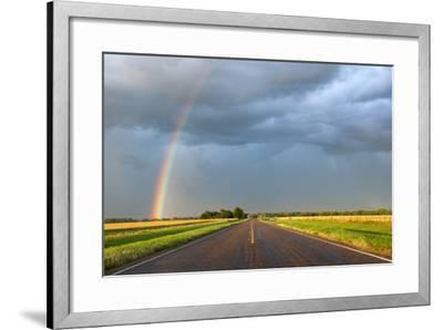 A Thunderstorm Produces a Vivid Rainbow Next to a Rain-Soaked Paved Road-Jim Reed-Framed Photographic Print