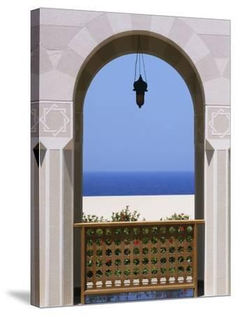 View Through Archway to Beach and Sea-Design Pics Inc-Stretched Canvas Print