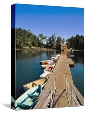 Old Wooden Pier and Boats in Harbor-Design Pics Inc-Stretched Canvas Print