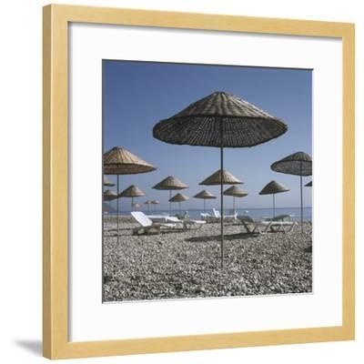 Palapas and Sun Loungers on Beach-Design Pics Inc-Framed Photographic Print