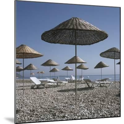 Palapas and Sun Loungers on Beach-Design Pics Inc-Mounted Photographic Print