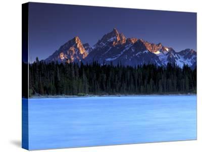 Jackson Lake and Tetons at Sunrise, Grand Teton National Park, Wyoming-Keith Ladzinski-Stretched Canvas Print
