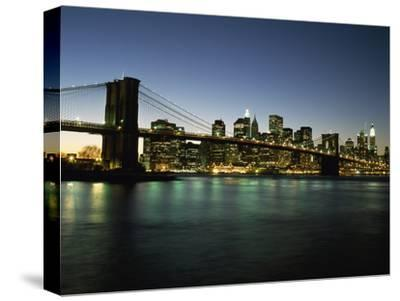 Looking across the East River and the Brooklyn Bridge to the Financial District at Dusk-Design Pics Inc-Stretched Canvas Print