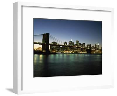 Looking across the East River and the Brooklyn Bridge to the Financial District at Dusk-Design Pics Inc-Framed Photographic Print