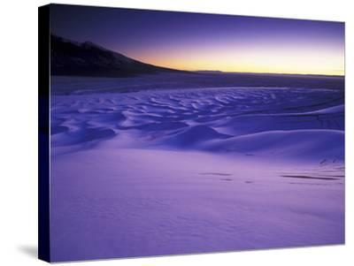 A Rarely Seen View of Snow-Covered Sand Dunes, at Twilight-Keith Ladzinski-Stretched Canvas Print