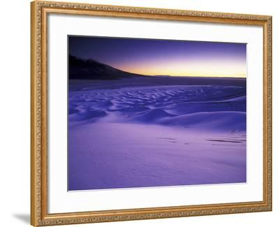 A Rarely Seen View of Snow-Covered Sand Dunes, at Twilight-Keith Ladzinski-Framed Photographic Print