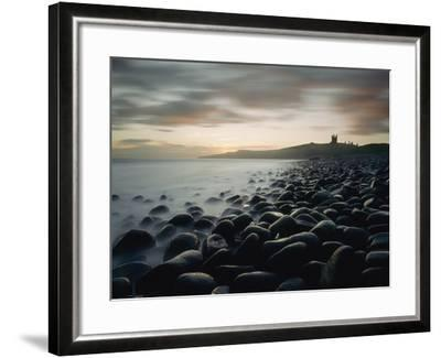 Looking Along Boulder Covered Beach Towards Dunstanburgh Castle at Dawn-Design Pics Inc-Framed Photographic Print