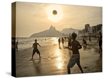 Young Men Play Beach Football on Ipanema Beach as the Sun Sets-Kike Calvo-Stretched Canvas Print